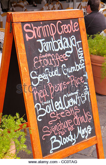 Louisiana New Orleans French Quarter French Market tent menu chalkboard blackboard Creole food jambalaya gumbo red - Stock Image
