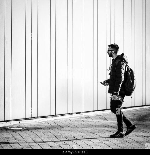 Man walking... - Stock Image