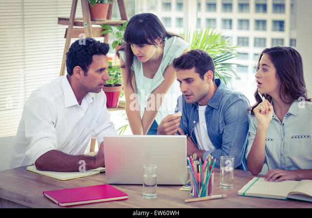 Group of young colleagues having a meeting - Stock Image