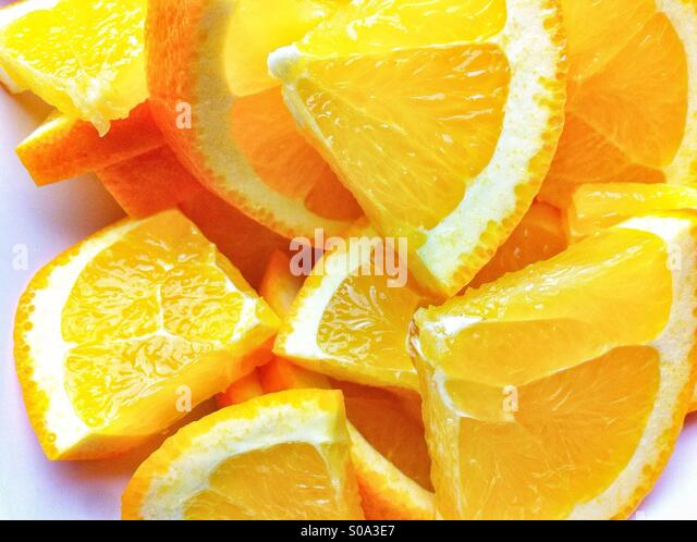 Pile of orange slices - Stock Image