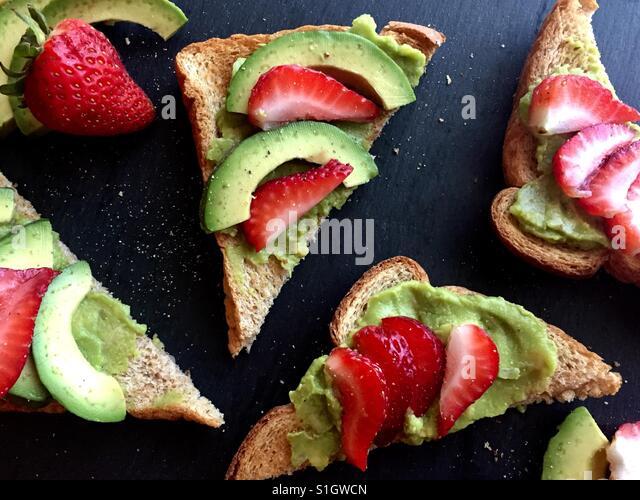 Avocado toast with strawberries - Stock Image