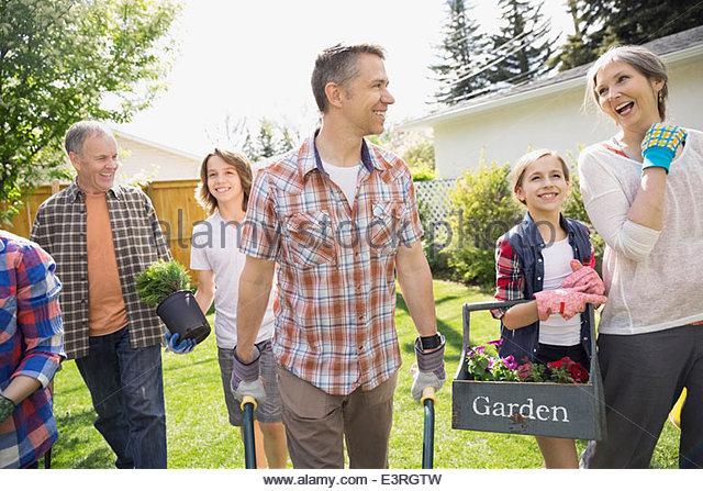 Multi-generation family gardening - Stock Image