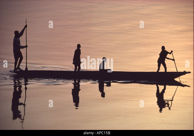 Pirogue dugout at Sunrise Congo Zaire River D R Congo Central Africa - Stock-Bilder