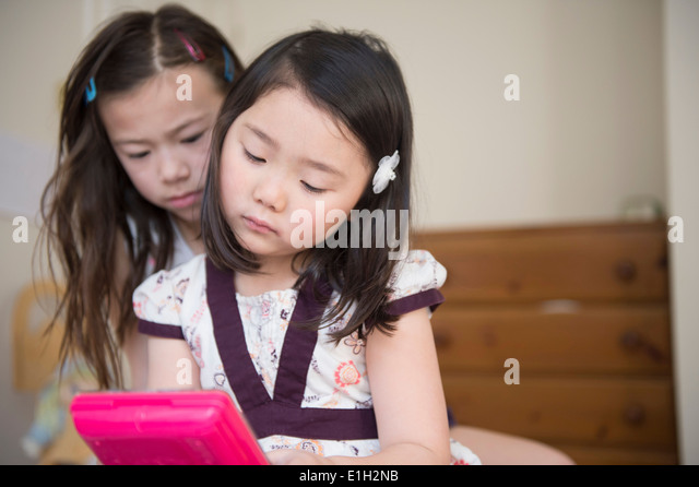 Two young female friends unhappy with one computer game - Stock-Bilder