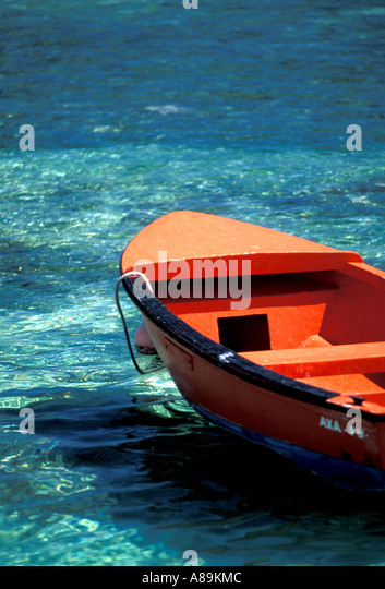 Tropics tropical red wood wooden fishing boat symbol - Stock Image