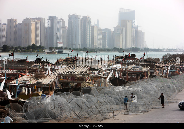 UAE Abu Dhabi Skyline at the corniche and fishing harbour - Stock Image