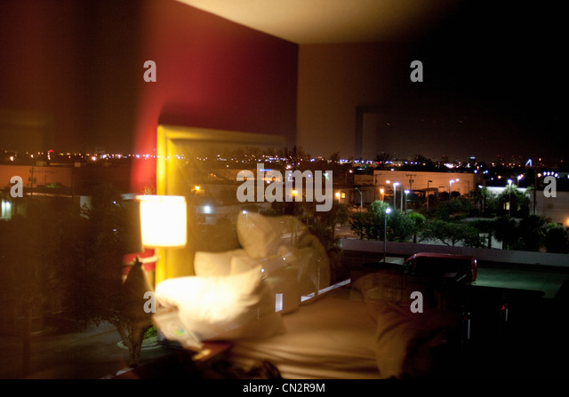 Hotel room at night - Stock Image