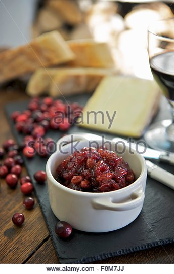Cranberry chutney with cheese - Stock Image