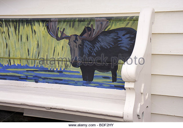 Michigan Upper Peninsula U.P. UP Lake Superior Munising public bench moose painting mural - Stock Image