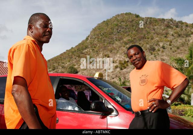 Sint Maarten Philipsburg Dutch Black male taxi cab drivers Point Blanche Mountain - Stock Image