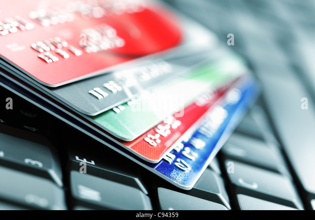 Credit card on laptop keyboard - Stock Image