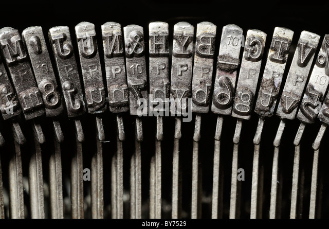 Close-up of old typewriter letter and symbol keys - Stock Image