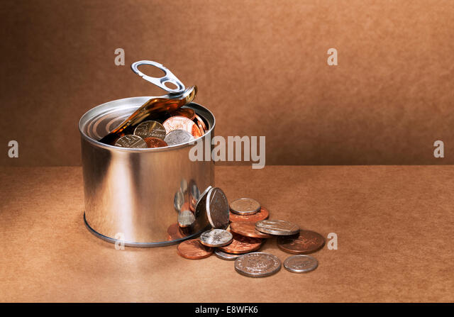 Sealed can overflowing with change - Stock Image