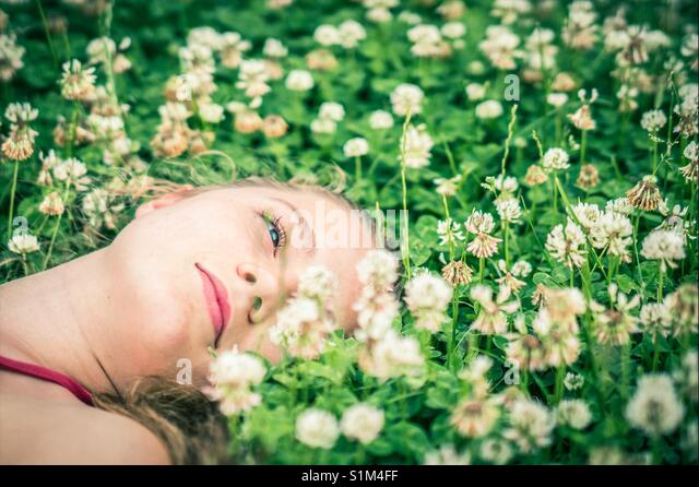 Lying in a clover field - Stock Image