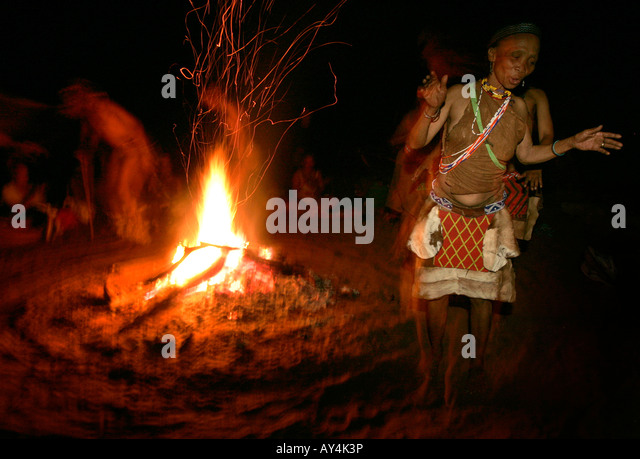 Ncoakhoe San bush woman performs ritual dance around a fire at D'Kar near Ghanzi in Botswana - Stock Image