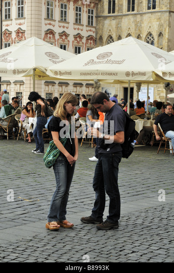 Tourists and diners in Prague Old Town Square - Stock Image