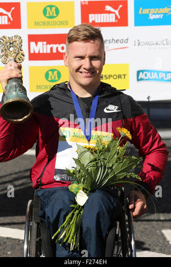 South Shields, UK. 13th Sep, 2015. David Weir celebrates winning the men's wheelchair race at the Great North - Stock Image