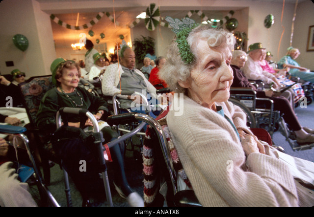 New Jersey Morristown nursing home residents seniors elderly St. Patrick's Day aging healthcare wheelchair - Stock Image