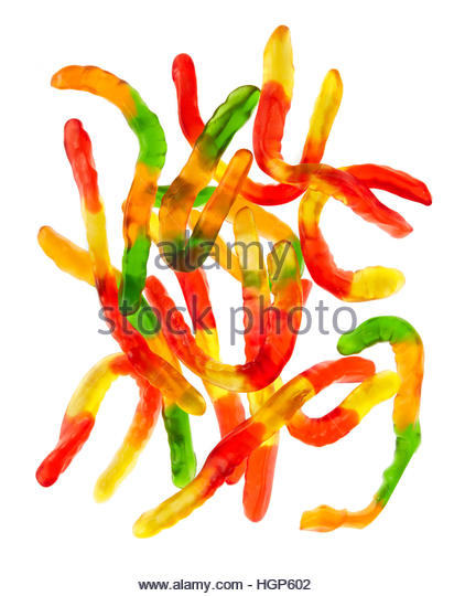 colorful sugary Worm Rubber Chewy candy - Stock Image