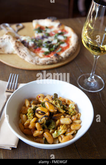 bowl of white bean, romanesco and mussels soup with white wine and a ...