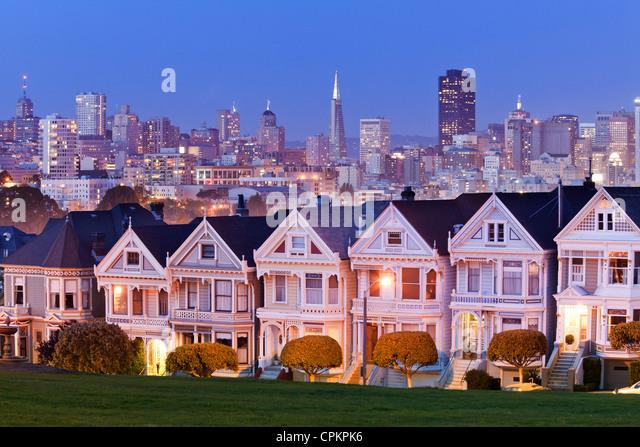 San Francisco skyline behind Victorian houses at night - California USA - Stock Image