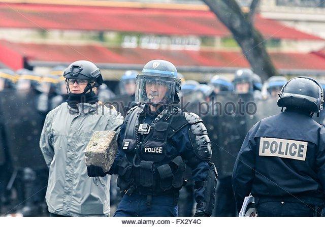 Paris,France. April 9th, 2016. FRANCE, Paris: A riot policeman holds a cobblestone during a demo on April 9, 2016 - Stock Image