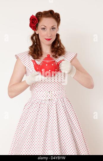Woman holding a teapot - Stock-Bilder