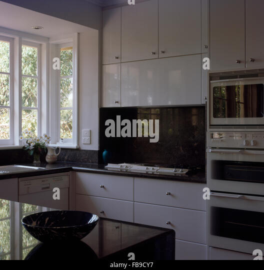 Modern kitchen appliances cooker stock photos modern for Tall fitted kitchen unit