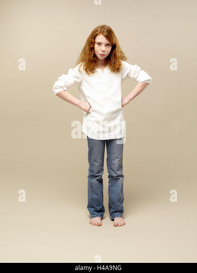 Girls, red-haired, decided, gesture, hands hips, child, long-haired, jeans, blouse, shirt, leisurewear, carelessly, - Stock Image