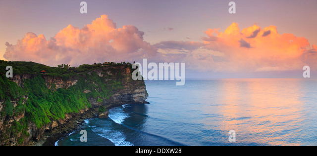 Bali, Bukit Peninsula, Uluwatu, Pura Luhur Uluwatu Temple at dawn, one of the most important directional temples - Stock Image