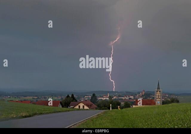 lightning in a woodland at daylight , Germany, Bavaria, Alpenvorland - Stock Image