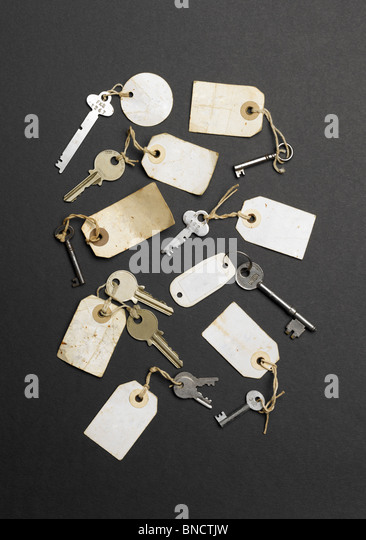 Old keys with labels without writing on them - Stock Image