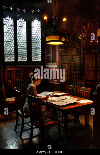 Reader in John Ryland Library Deansgate Manchester - Stock Image