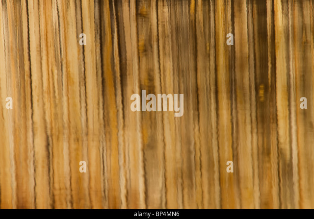 Shown here is a reflection of wooden bridge in water.  Brown Line Pattern Reflection of Wooden Bridge On Water - Stock Image