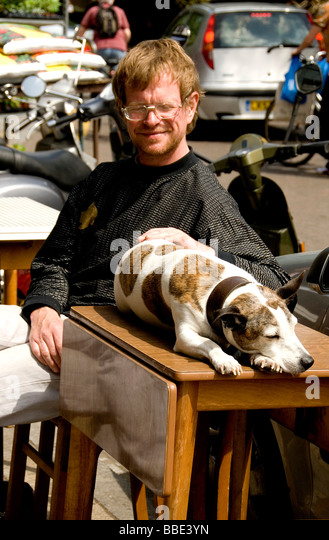 A man and his dog present a peaceful image in Borough Market - Stock-Bilder