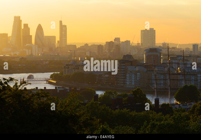 Summer Evening view up River Thames towards City of London from Greenwich Park  (Masts of Cutty Sark middle right - Stock Image