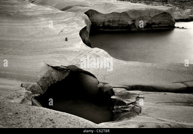 Milos island, volcanic rocks in Sarakiniko beach (slow shutter speed-black & white version). - Stock Image