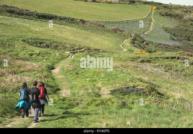 People hiking along the South West Coast Path near Boscastle in Cornwall, England, UK - Stock Image