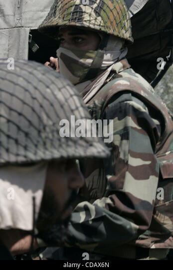 An indian army soldisrs petroling  during a curfew in  Srinagar,the summer capital of indian kashmir  on ,Thursday, - Stock Image