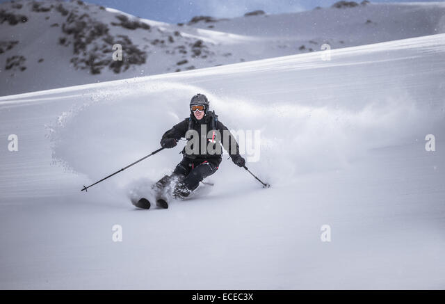 Austria, Front view of free ride skier downhill skiing - Stock Image