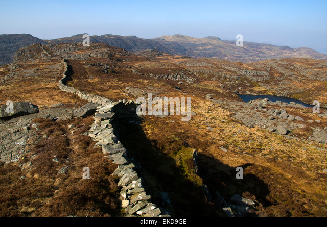 Llyn Pryfed tarn on the ridge of Craig Wion, in the north of the Rhinog Mountains, Snowdonia, North Wales, UK - Stock Image