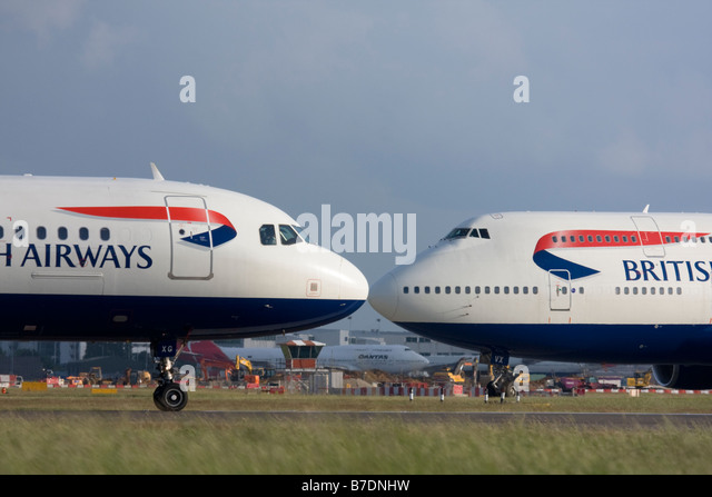 Short-haul and long-haul British Airways planes taxiing for departure at London Heathrow Airport, United Kingdom - Stock Image