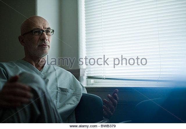 Senior male nurse in hospital - Stock Image
