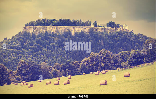 Retro toned landscape with fortress Koenigstein before rain, Germany. - Stock Image