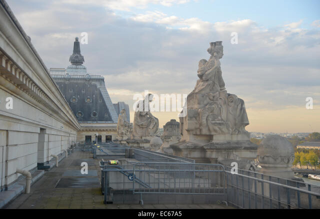 Paris sky from the roof of the Musee d'Orsay , statues in the soft evening light - Stock Image