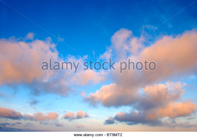 cumulus cloudscape at sunset over the Cyclades Island of Ios, Greece. - Stock Image