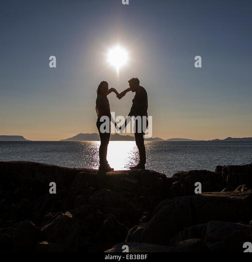 Man and Woman making heart silhouette - Stock-Bilder
