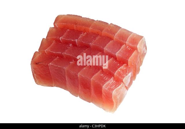 Slices of raw bluefin tuna used in sashimi isolated on white background - Stock Image