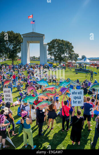 Climate Change Knows No Borders. International rally at Peace Arch U.S Canada border crossing. - Stock Image