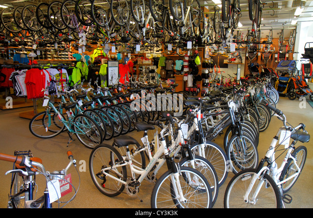 Maine Freeport Main Street Route 1 L. L. Bean shopping bike boating skiing inside bicycles retail display for sale - Stock Image